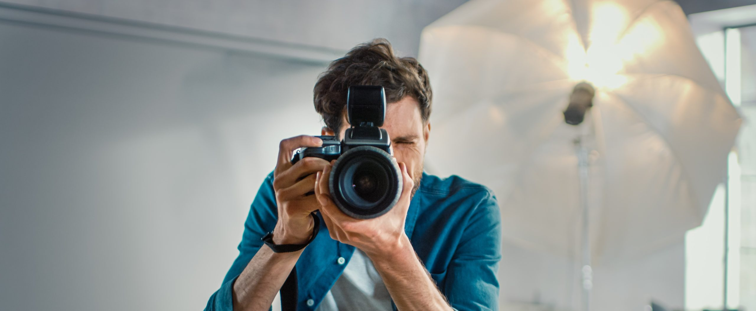 man with camera in the photo studio