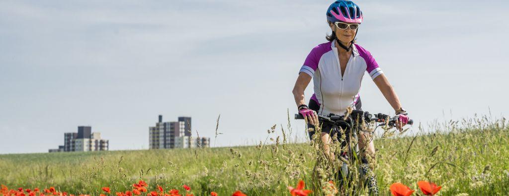 women and electric bike on flower field